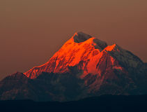 Colorful dusk on mount Trishul Stock Photography