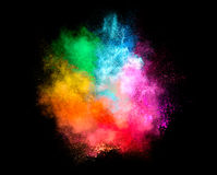 Colorful Dust Particle Explosion Isolated on Black Background Stock Photos