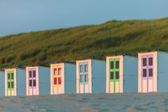 Colorful Dutch beach houses. Colorful Dutch wooden beach houses in front of dunes Royalty Free Stock Images