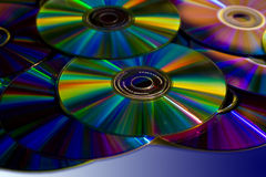 Colorful DVDs and CDs. A stack of colorful  DVD's isolated Stock Photography
