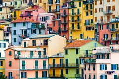 Colorful dwellings. Full background with colorful buildings. Manarola, Cinque Terre National Park, Italy Stock Photos