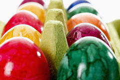 Colorful, dyed Easter eggs in carton Royalty Free Stock Photos