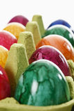 Colorful, dyed Easter eggs in carton Stock Images