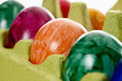 Colorful, dyed Easter eggs in carton Royalty Free Stock Photo