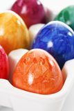 Colorful, dyed Easter eggs in carton Royalty Free Stock Photography