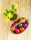 Colorful dyed Easter eggs on wooden table Royalty Free Stock Photos