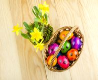 Colorful dyed Easter eggs on wooden table Stock Photos
