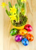 Colorful dyed Easter eggs on wooden table Royalty Free Stock Images