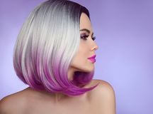 Colorful dyed Ombre hair extensions. Fashion haircut. Beauty Mod. El Girl blonde with short bob purple hairstyle isolated on purple background. Closeup woman Royalty Free Stock Photos