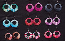 Colorful earrings. Funny earrings in different colors stock image