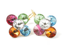 Colorful earrings. Golden earrings with colorful gems on white Royalty Free Stock Images