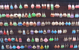 Colorful earrings at the bazaar Royalty Free Stock Photo