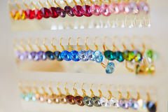 Colorful earrings in a jewelry Royalty Free Stock Photos