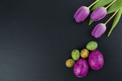 Colorful Easter And Quail Eggs And Tulip Flowers On Stone Table. Top View With Copy Space Royalty Free Stock Photo