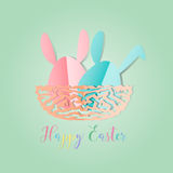 Colorful Easter bunnies in easter eggs on nest egg on gray backg Royalty Free Stock Photos