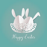Colorful Easter bunnies in easter eggs on nest egg on gray backg Stock Photos