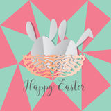 Colorful Easter bunnies in easter eggs on nest egg on gray backg Stock Photography