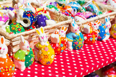 Colorful Easter Bunny figurines at the market Royalty Free Stock Photos