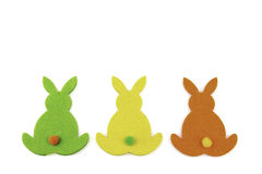 Colorful Easter Bunny Trio. Bunnys backs in different colours made of fleece Royalty Free Stock Image