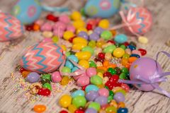 Colorful easter candies and eggs stock photos