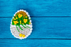 Colorful easter cookie on blue wooden background. Big Easter cookie with icing sword lily Stock Image