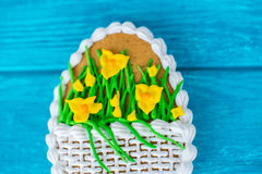 Colorful easter cookie on blue wooden background macro. Big Easter cookie with icing sword lily  macro Stock Image