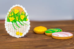 Colorful easter cookies on brown wooden background Stock Photo