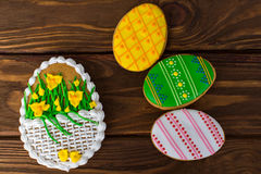 Colorful easter cookies on brown wooden background. Big Easter cookies with icing sword lily and three small cookies Stock Image