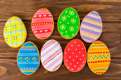 Colorful easter cookies on brown wooden background Stock Images