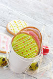 Colorful easter cookies and eggs Royalty Free Stock Photos