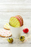 Colorful easter cookies and eggs Stock Photos