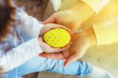 Colorful easter cookies in kids hands. Holiday Easter, yellow egg stock image