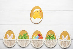 Free Colorful Easter Cookies On Blue Wooden Background Stock Photos - 68683523
