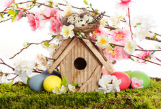 Colorful easter decoration with birdhouse and eggs Stock Photos