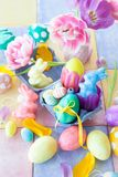 Colorful easter decorations. On fresh spring flowers royalty free stock image