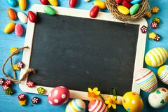 Colorful Easter egg background with blank slate stock photography