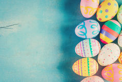 Colorful easter egg on blue pastel color wood background with sp. Ace royalty free stock image