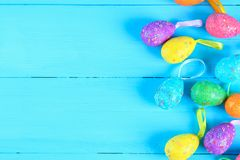 Colorful easter egg on blue pastel color wood background with space.  Stock Photos