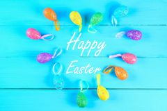 Colorful easter egg on blue pastel color wood background with space. Happy easter. Colorful easter egg on blue pastel color wood background with space. Happy Stock Photo