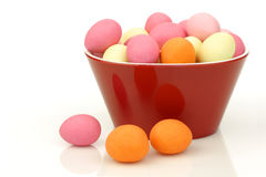 Colorful easter egg candy in a red bowl Royalty Free Stock Image