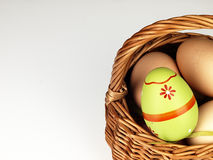 Colorful Easter egg in the company of ordinary eggs. Royalty Free Stock Photography