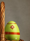 Colorful Easter egg in the company of ordinary eggs. Royalty Free Stock Photos