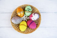 Colorful Easter egg design in round basket Royalty Free Stock Image