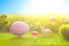 Colorful Easter egg with easter bunny in fresh spring meadow. royalty free stock photography
