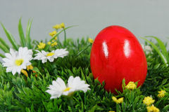 Colorful easter egg. S on a lawn of artificial green stock photo