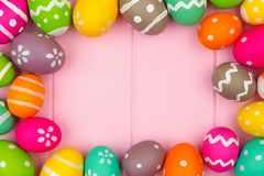 Colorful Easter egg frame against a pink wood background Stock Photography