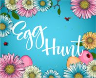 Colorful Easter egg hunt calligraphy phrase with floral and eggs decor stock illustration