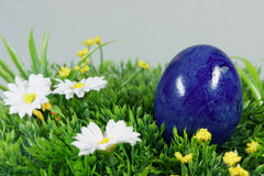 Colorful easter egg. On a lawn of artificial green stock image