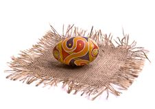 Colorful Easter egg on the napkin, isolated. Stock Image