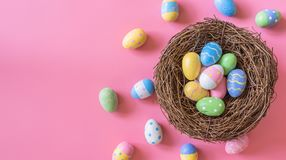 Colorful easter egg and nest on pink pastel color background wit Stock Photo